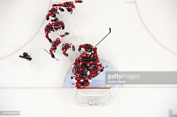 2014 Winter Olympics Aerial view of Canada goalie Carey Price and teammates victorious on ice after winning Men's Gold Medal Game vs Sweden at...