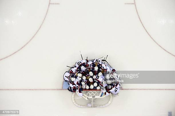 2014 Winter Olympics Aerial view of Team USA in huddle in front of net before game vs Canada before Women's Gold Medal Game at Bolshoy Ice Dome Sochi...