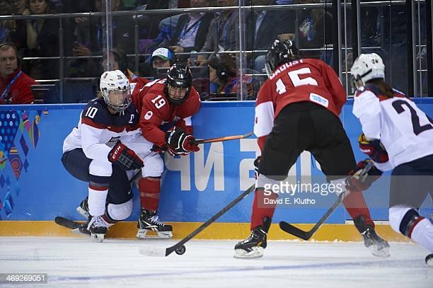 2014 Winter Olympics Canada Brianne Jenner in action vs USA Meghan Duggan during Women's Preliminary Round Group A at Shayba Arena Sochi Russia...