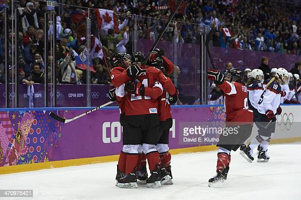 Winter Olympics: Canada Brianne Jenner victorious with Haley Irwin after scoring goal vs USA during Women's Gold Medal game at Bolshoy Ice Dome. USA...