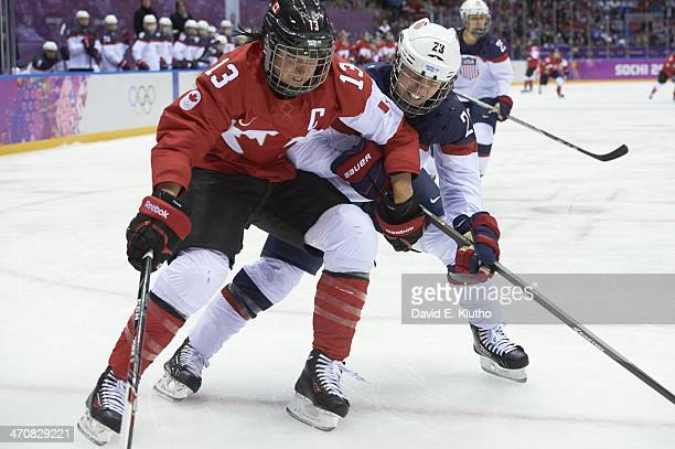 2014 Winter Olympics Canada Caroline Ouellette in action vs USA Michelle Picard during Women's Gold Medal Game at Bolshoy Ice Dome Canada wins gold...