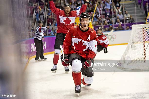 2014 Winter Olympics Canada Jonathan Toews victorious with Jeff Carter after scoring goal at 1255 of 1st period during Men's Gold Medal Game vs...