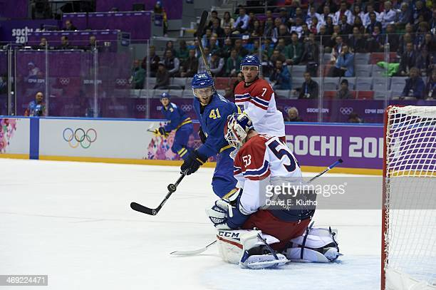 2014 Winter Olympics Czech Republic goalie Alexander Salak and Tomas Kaberle in action vs Sweden Gustav Nyquis during Men's Preliminary Round Group C...
