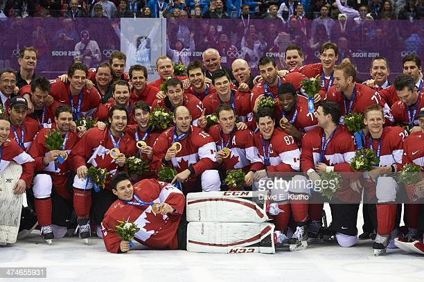 2014 Winter Olympics Portrait of Team Canada players victorious posing with medals on ice after winning Men's Gold Medal Game vs Sweden at Bolshoy...
