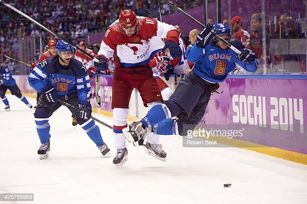 2014 Winter Olympics Russia Evgeni Malkin in action check by Finland Sami Vatanen as Tuomo Ruutu watches during Men's Playoffs Quarterfinals at...
