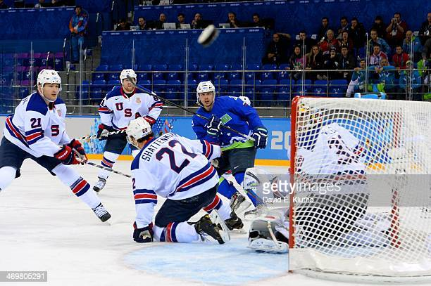 2014 Winter Olympics Slovenia Jan Mursak in action watching shot go wide vs USA during Men's Preliminary Round Group A game at Shayba Arena Sochi...