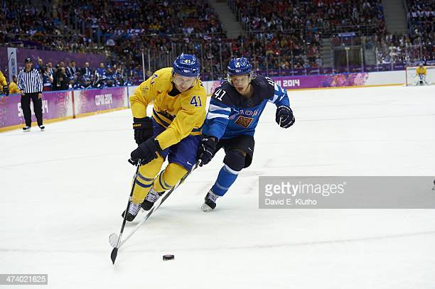 2014 Winter Olympics Sweden Gustav Nyquist in action vs Finland Antti Pihlstrom during Men's Playoffs Semifinals at Bolshoy Ice Dome Sochi Russia...