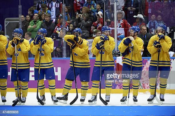 2014 Winter Olympics Sweden Markus Kruger Jakob Silfverberg Nicklas Backstrom Alexander Steen Loui Eriksson and Daniel Sedin upset during medal...