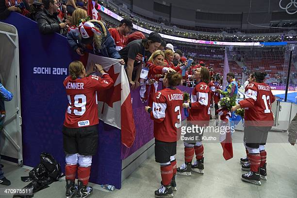 Winter Olympics: Team Canada Brianne Jenner , Jocelyne Larocque , and Tara Watchorn victorious, holding medals and talking to fans after winning...