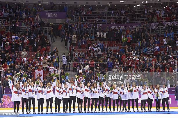 2014 Winter Olympics Team Switzerland victorious on medal stand after winning bronze medals during ceremony at Bolshoy Ice Dome Sochi Russia...