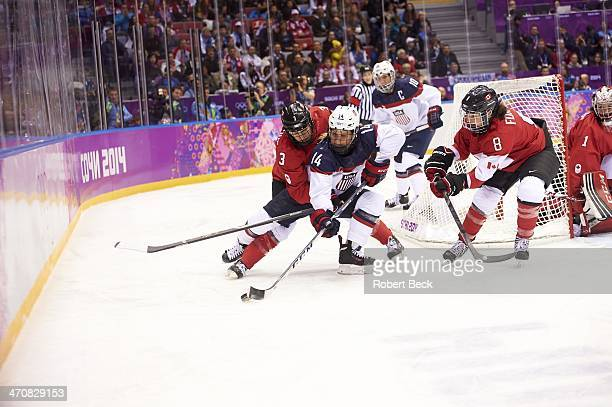 2014 Winter Olympics USA Brianna Decker in action vs Canada Jocelyne Larocque and Laura Fortino during Women's Gold Medal Game at Bolshoy Ice Dome...