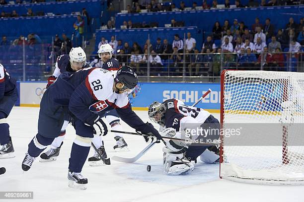 2014 Winter Olympics USA goalie Jonathan Quick in action making save vs Slovakia Phil Kessel and Michal Handzus during Men's Preliminary Round Group...