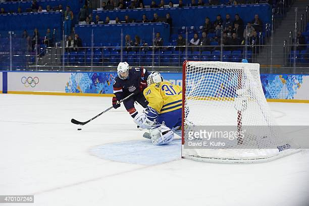 2014 Winter Olympics USA Jocelyne Lamoureux in action vs Sweden goalie Kim Martin Hasson during Women's Semifinals at Shayba Arena Sochi Russia...
