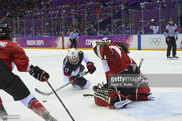 2014 Winter Olympics USA Jocelyne Lamoureux in action vs Canada goalie Shannon Szabados during Women's Gold Medal game at Bolshoy Ice Dome Sochi...