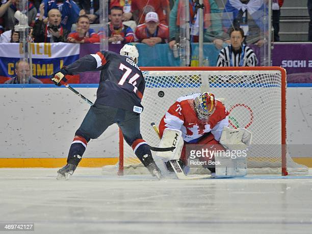 2014 Winter Olympics USA TJ Oshie in action scoring goal vs Russia goalie Sergei Bobrovsky during shootout of Men's Preliminary Round Group A game at...