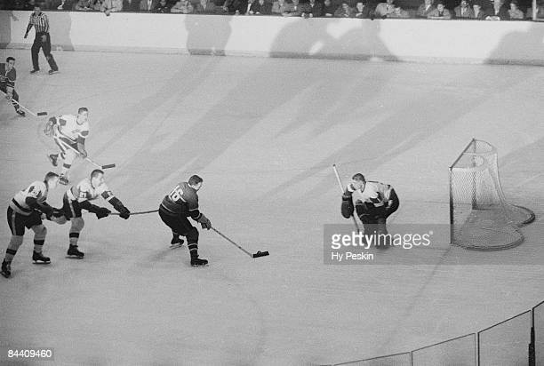 Aerial view of Montreal Canadiens Henri Richard in action vs Detroit Red Wings goalie Terry Sawchuk Montreal Canada 11/2/1957 CREDIT Hy Peskin