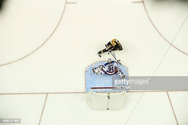 Aerial view of New York Rangers goalie Henrik Lundqvist in action vs Pittsburgh Penguins Evgeni Malkin at Consol Energy Center Pittsburgh PA CREDIT...