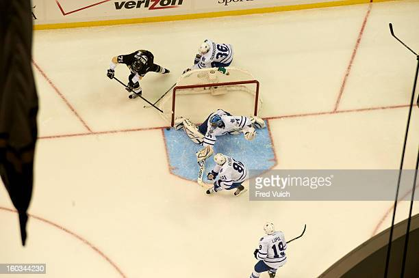 Aerial view of Toronto Maple Leafs goalie James Reimer and Carl Gunnarsson in action vs Pittsburgh Penguins Evgeni Malkin at Consol Energy Center...