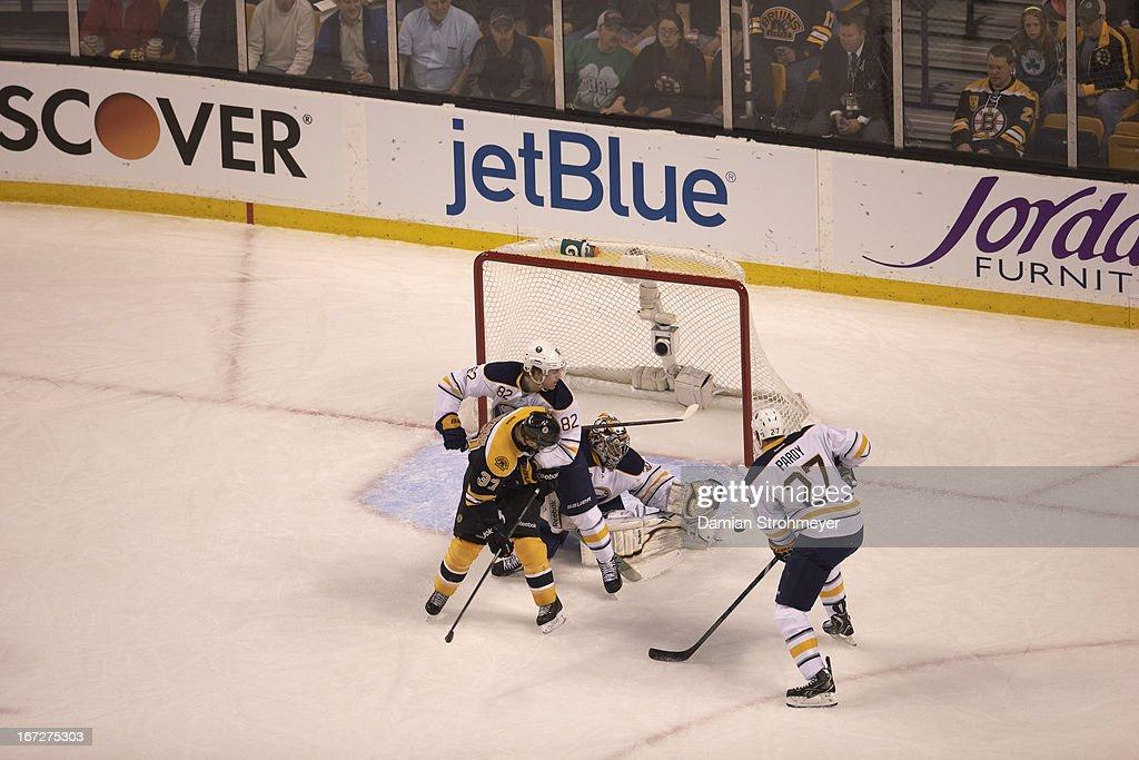 Buffalo Sabres Ryan Miller (30) in action, shot vs Boston Bruins at TD Garden. Damian Strohmeyer F72 )