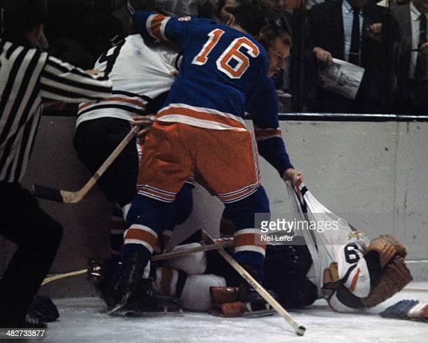Chicago Blackhawks Reg Fleming down on ice during fight vs New York Rangers Eddie Shack at Madison Square Garden New York NY CREDIT Neil Leifer