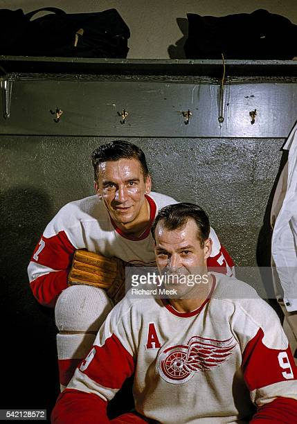 Closeup portrait of Detroit Red Wings Ted Lindsay and Gordie Howe during photo shoot in locker room at Olympia Stadium Cover Detroit MI CREDIT...