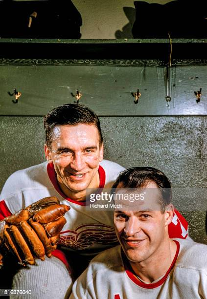 Closeup portrait of Detroit Red Wings Ted Lindsay and Gordie Howe during photo shoot in locker room at Olympia Stadium Detroit MI CREDIT Richard Meek