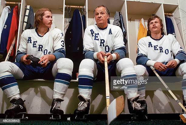 Closeup portrait of Houston Aeros Gordie Howe with sons Marty Howe and Mark Howe posing in locker room before game vs Edmonton Oilers at Sam Houston...