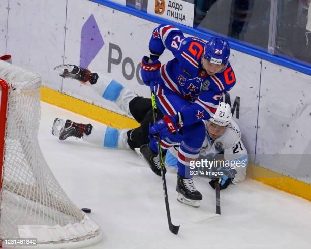 Hockey Club player, Vasily Tokranov and Dynamo Minsk Hockey Club player, Alexey Protas in action during the Kontinental Hockey League, playoffs, 1/4...