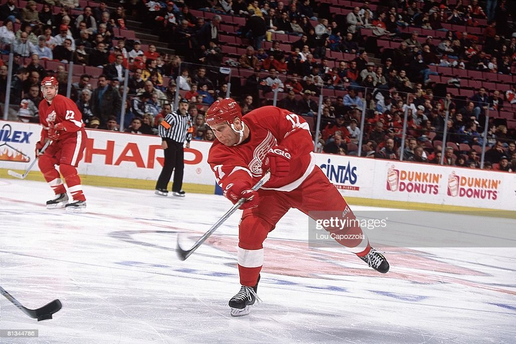 check out 1d621 cdfc7 Detroit Red Wings Brett Hull in action, taking shot vs New ...