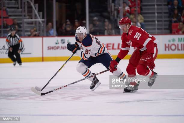 Edmonton Oilers Connor McDavid and Ryan Strome in action vs Detroit Red Wings Anthony Mantha at Little Ceasars Arena Detroit MI CREDIT David E Klutho