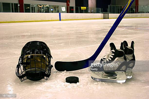 Hockey equipment displayed on ice in rink