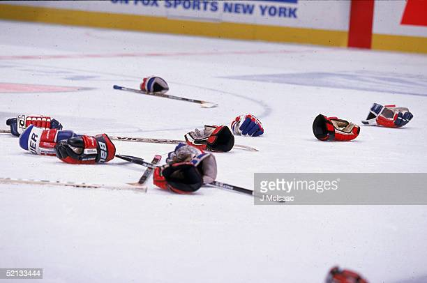 Hockey equipment litters the ice after a fight New York April 1999