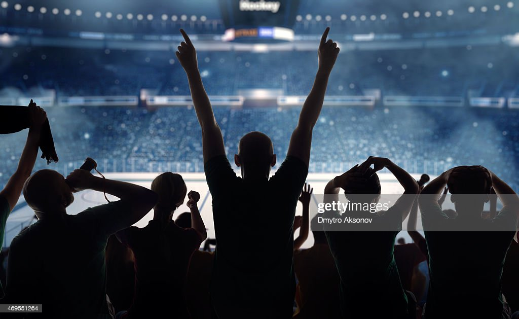 Hockey fans at stadium : Stock Photo