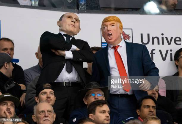 Hockey fans dress as Russian President Vladimir Putin and United States President Donald Trump watch Semifinals hockey action of the 2019 IIHF World...