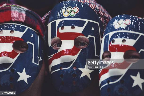 Hockey fans from the United States show their team support by wearing goalie masks during the Group B United States versus Italy game on 21 February...