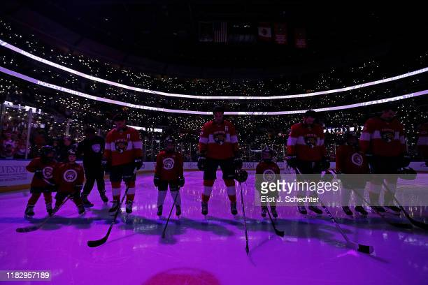 Hockey fans illuminate the arena for Hockey Fights Cancer Night between the Florida Panthers and the New York Rangers at the BB&T Center on November...