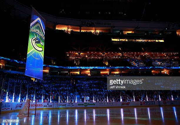 Hockey fans look on before the start of the NHL game between the Vancouver Canucks and the Tampa Bay Lightning at Rogers Arena October 18, 2014 in...
