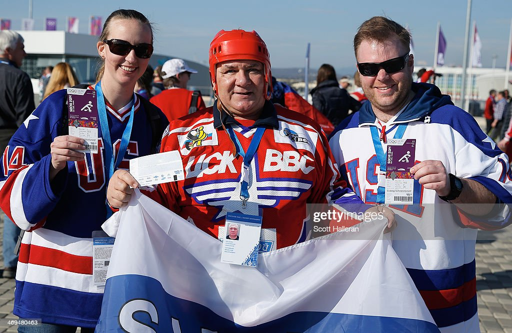 Hockey fans pose for a photo outside Bolshoy Ice Dome prior to the start of the USA v Russia hockey game on February 15, 2014 in Sochi, Russia.