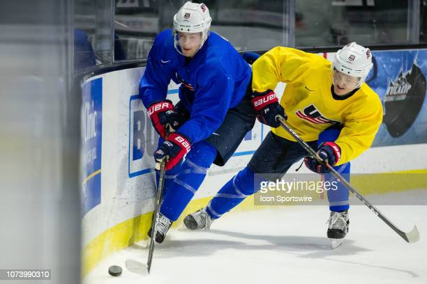 Hockey forward Ryan Poehling battles for the puck with Mikey Anderson during the first USA practice on Saturday December 15 2018 at Angel of the...
