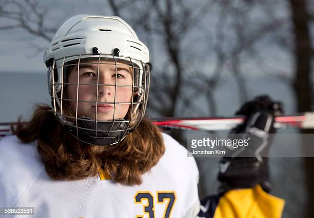 hockey girl portrait. - hockey stick stock pictures, royalty-free photos & images