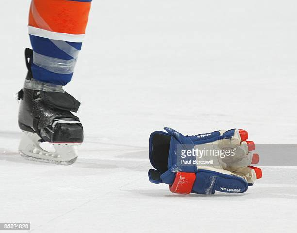A hockey glove is kicked along the ice after a fight as the Tampa Bay Lightning and the New York Islanders played in a National Hockey League game at...