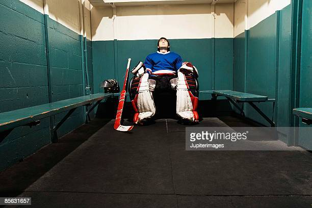 hockey goalie in locker room - goalkeeper stock pictures, royalty-free photos & images