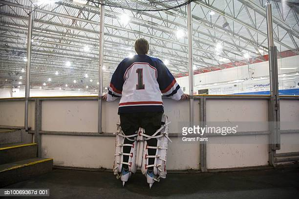hockey goalie (14-15) looking at rink, rear view - hockey player stock pictures, royalty-free photos & images