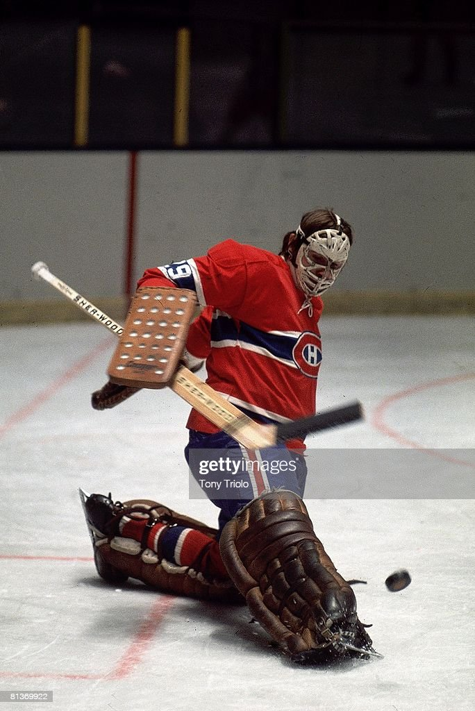 Goaltender Ken Dryden Of The Montreal Canadiens Makes A Kick Save