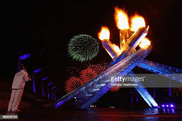 Hockey great Wayne Gretzky lite the Olympic Cauldron as fireworks are shot off during the Opening Ceremony of the 2010 Vancouver Winter Olympics at...