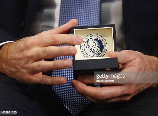2014 Hockey Hall of Fame inductee Dominik Hasek looks at his Hall ring during a photo opportunity at the Hockey Hall of Fame on November 14 2014 in...
