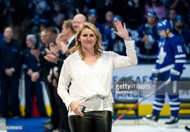 Hockey Hall of Fame inductee Hayley Wickenheiser waves to the crowd during a pregame ceremony at the Scotiabank Arena on November 15 2019 in Toronto...