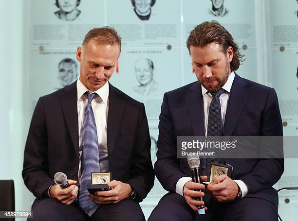 Hockey Hall of Fame inductees Dominik Hasek and Peter Forsberg look at the Hall rings during a photo opportunity at the Hockey Hall of Fame on...