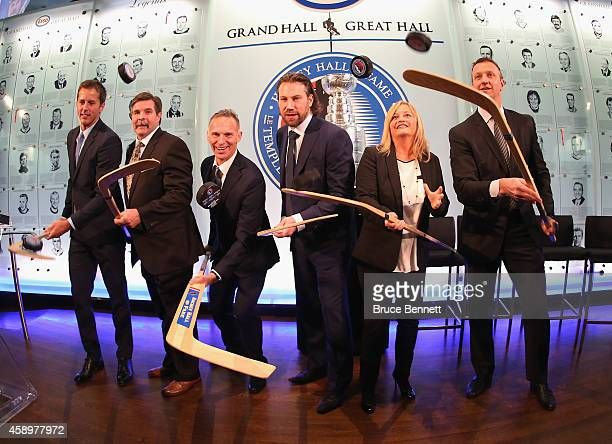 Hockey Hall of Fame inductees Mike Modano, Bill McCreary, Dominik Hasek, Peter Forsberg, Line Gignac Burns , and Rob Blake, take part in a photo...