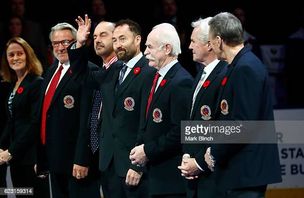 Hockey Hall of Fame member Ed Belfour waves prior to the Hall of Fame game between the Toronto Maple Leafs and the Philadelphia Flyers at the Air...